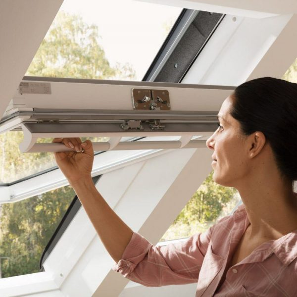 Velux window with woman opening it