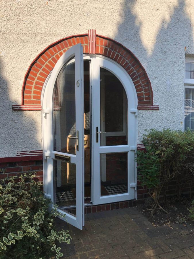 White uPVC arched door Byfleet