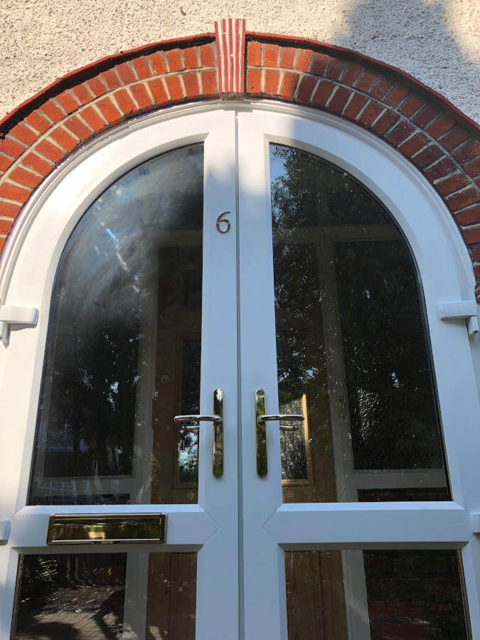 White uPVC arched door Byfleet close up