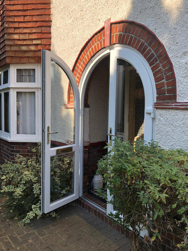 white uPVC arched door exterior