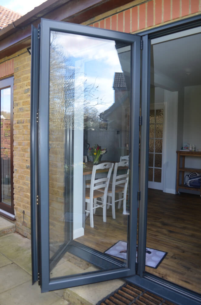 Anthracite grey bifold doors opened