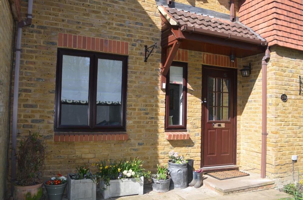 uPVC slimline windows and entrance door in Rosewood