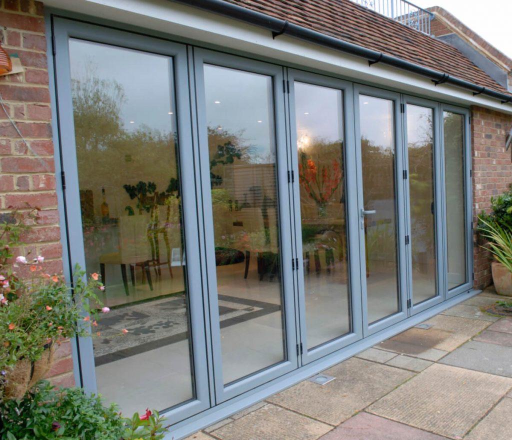 Aluminium bi-folding doors in Grey