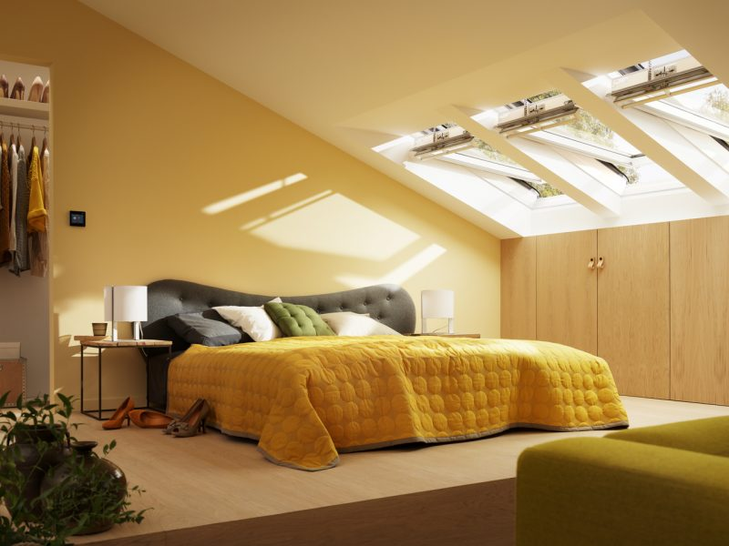 Velux windows in yellow bedroom