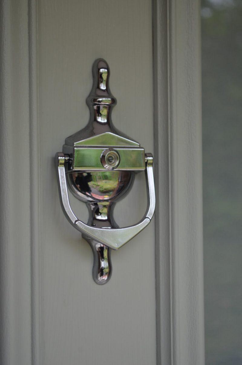 Chrome door knocker with spyhole