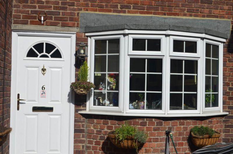 Slimline windows and composite door in white