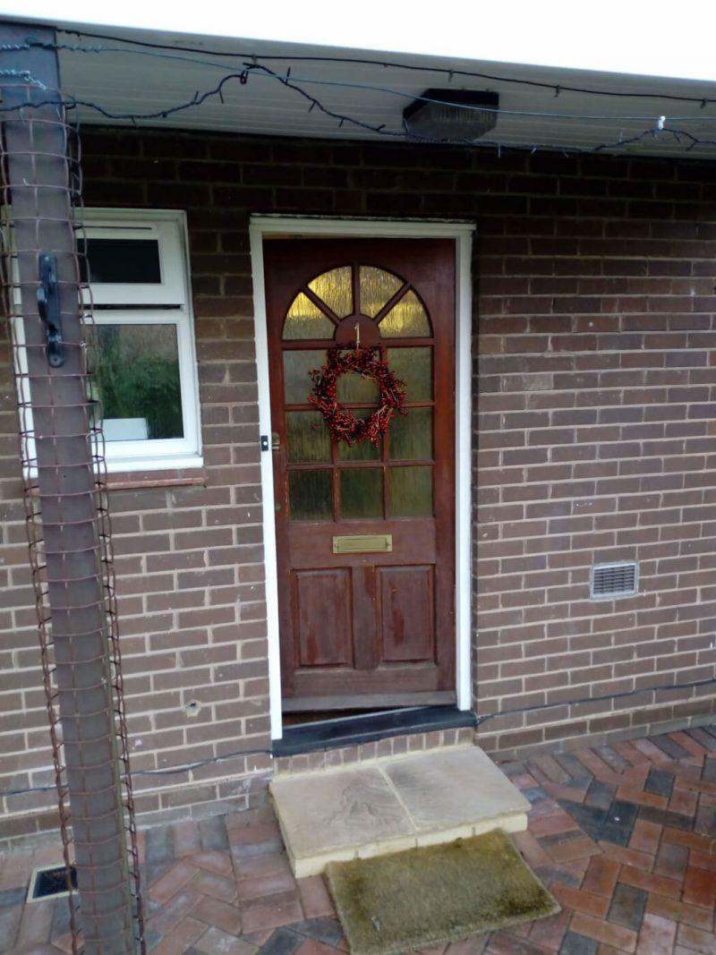Brown timber door before replacement