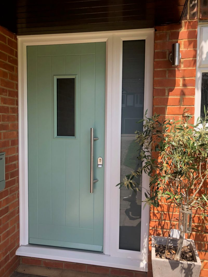Composite door in chartwell green with side panel