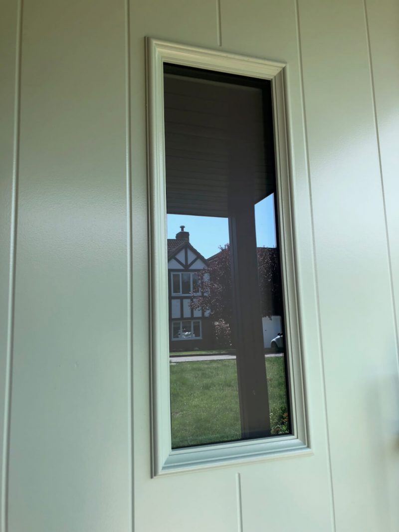 Glass panel on composite door
