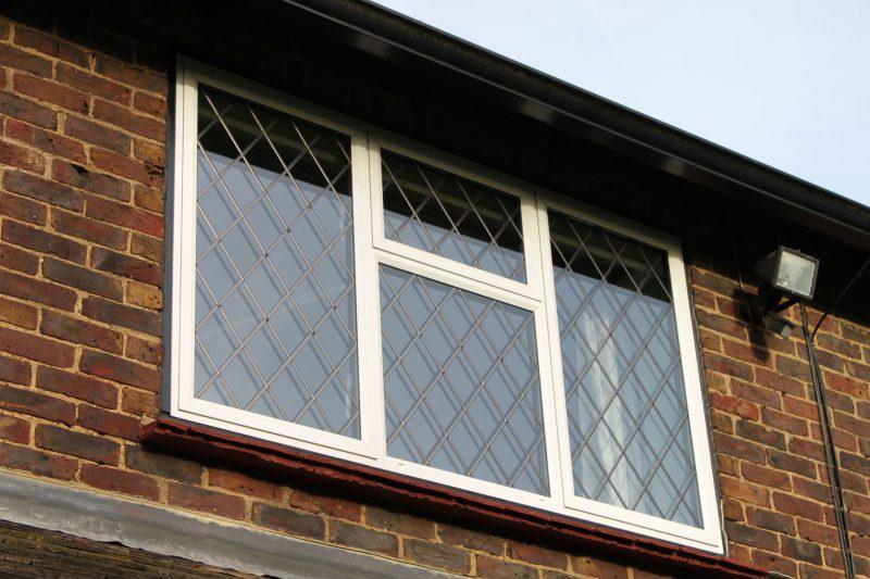 White aluminium secondary glazed window with leads