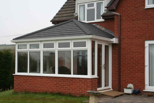 White upvc conservatory with guardian roof