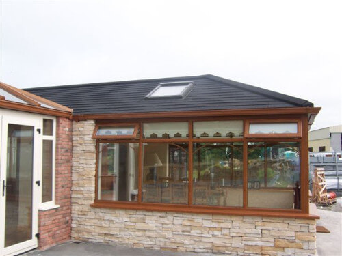 wood style conservatory with tiled roof
