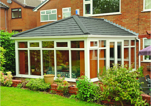 white upvc conservatory with tiled roof