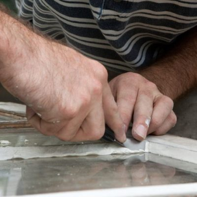 Glass being cut